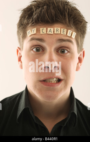 Man with the words 'my career' spelled with letter tiles on his head - Stock Photo