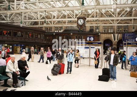 UK Scotland Glasgow Central Railway Station main concourse passengers waiting - Stock Photo
