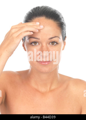 Woman Applying Foundation Model Released - Stock Photo