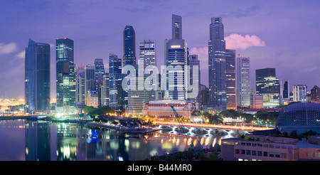Asia Singapore Singapore Skyline Financial district at dusk - Stock Photo