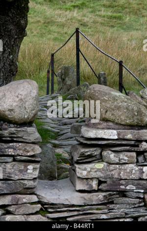 Slater Bridge through stone stile, Little Langdale, Lake Ditrict, Cumbria - Stock Photo