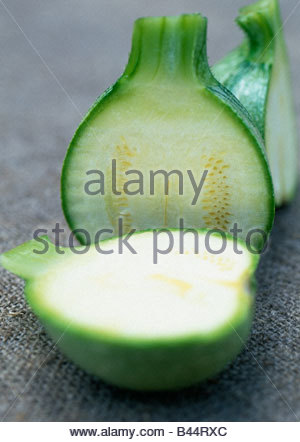 Round courgette cut in half - Stock Photo