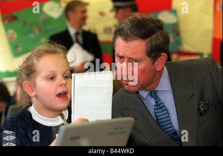 Prince Charles December 1998 Visting a school in Norwich looking at a young girls work - Stock Photo