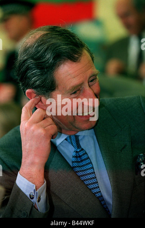 Prince Charles December 1998 Visting a school in Norwich scratching ear - Stock Photo