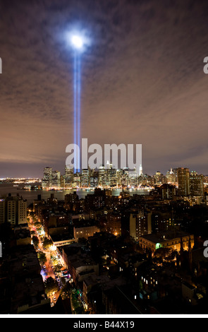 Tribute in Light memorial lights as seen from Brooklyn shining high above Manhattan - Stock Photo
