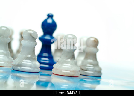 Chess game with blue and white onyx pieces - Stock Photo