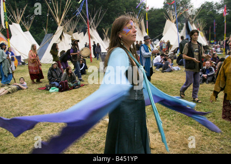 Before an evening ceremony in the Tipi field a woman dances Glastonbury Music Festival 2003 - Stock Photo