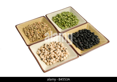 four dishes of lentils, peas, beans, black eyed peas - Stock Photo