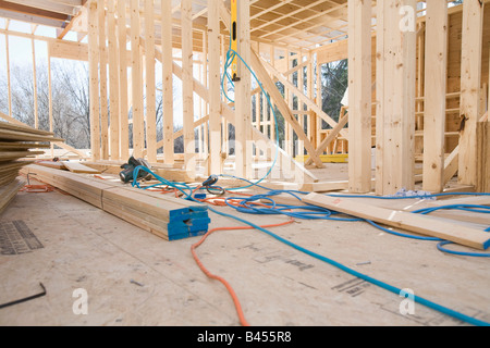 Plans for interior room under construction. - Stock Photo