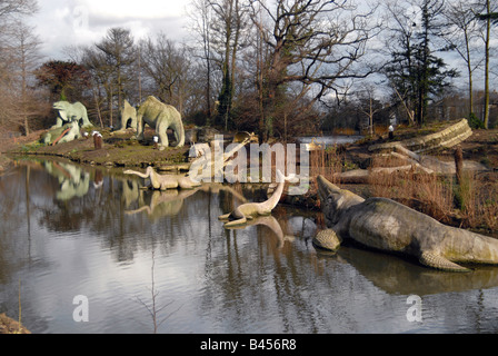 The dinosaur sculptures which were constructed in 1854 by a lake in Dinosaur Court, Crystal Palace Park, London, - Stock Photo