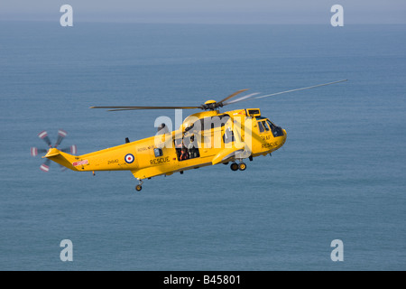 RAF helicopter air sea rescue on cliffs above Widemouth Bay Bude Cornwall UK - Stock Photo