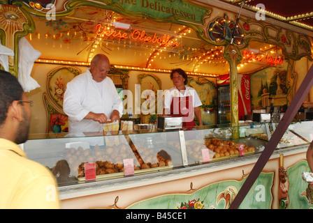 market stall selling pancakes and crepes at Efteling Theme park Kaatsheuvel Netherlands - Stock Photo