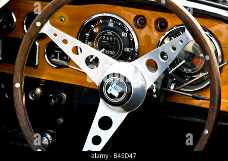 Dash and steering wheel in a Triumph TR 4A car - Stock Photo