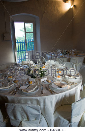 Indoor wedding dinner table place setting - Stock Photo