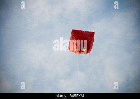 Hot air balloon lifting up in sky - Stock Photo