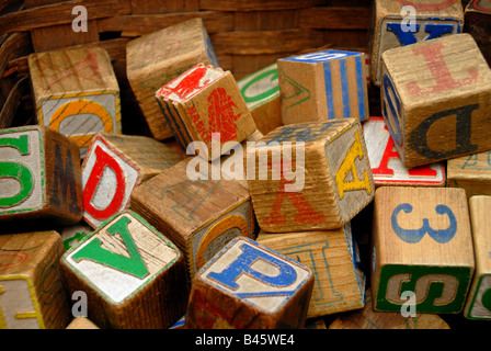 Vintage wooden blocks with colorful letters and numbers on them, in an antique store. - Stock Photo