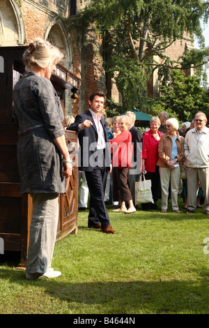 Julian Bly during filming of the BBC TV The Antiques Roadshow program with members of the public audience at Wells - Stock Photo