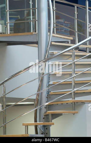 Stainless steel spiral staircase in a modern open plan office