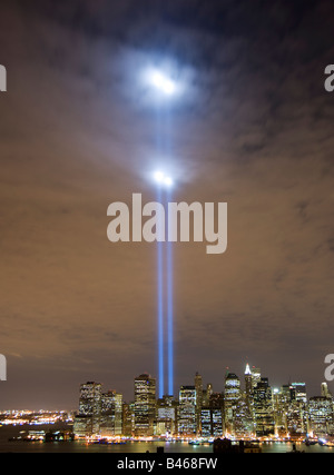 Tribute in Light memorial lights shine high above Manhattan illuminating the clouds - Stock Photo