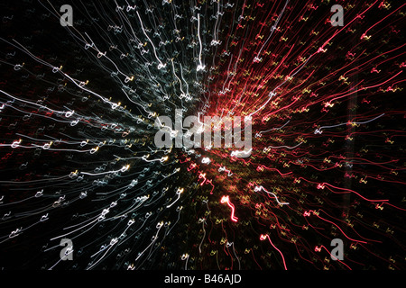 Red ,white and orange flashes on a black background like outer space - Stock Photo