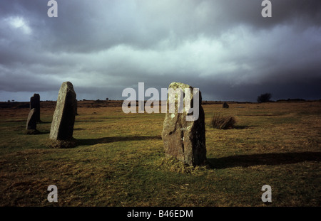 The Hurlers stone circle on Bodmin Moor lit by sunlight after a storm - Stock Photo