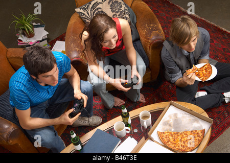 People in Lounge with Video Game