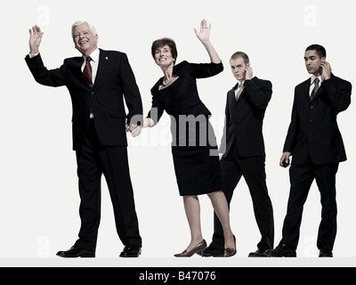 Politician and wife with bodyguards - Stock Photo