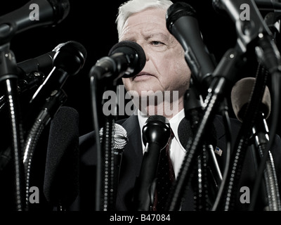 Politician and microphones - Stock Photo