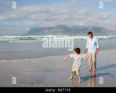 child throwing stone into sea stock photo 10740761 alamy. Black Bedroom Furniture Sets. Home Design Ideas