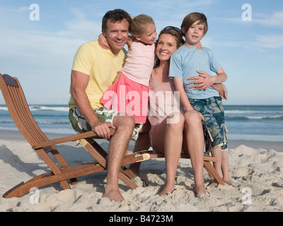 Family on a lounge chair - Stock Photo
