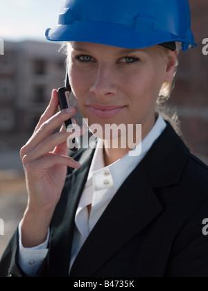 Engineer on cellphone - Stock Photo
