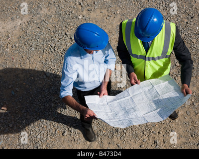 Architects with blueprint - Stock Photo