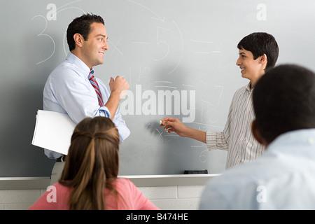 A teacher and a highschool student - Stock Photo