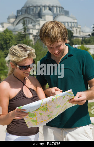 Couple in istanbul with map - Stock Photo