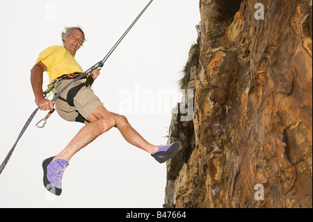 Man abseiling - Stock Photo