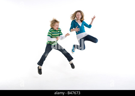 A boy and girl jumping - Stock Photo