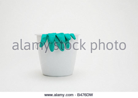 Rubber gloves and a bucket - Stock Photo