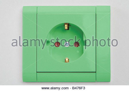 A green electrical socket - Stock Photo
