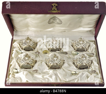 Empress Auguste Victoria - six small silver salt dishes in a chest., Openworked silver dishes in the Rococo style. - Stock Photo