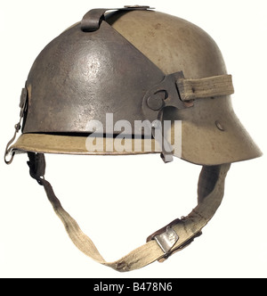 A Berndorf type steel helmet with a supplementary front shield., Dirt-brown, lacquered steel bowl with the rim turned - Stock Photo
