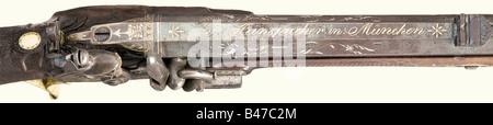 A flintlock rifle, Franz Rinspacher, Munich, circa 1825. Octagonal barrel, seven groove rifled bore in 12 mm calibre - Stock Photo