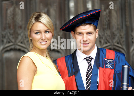 Steven Gerrard with wife Alex Curran received an Honorary Fellowship from Liverpool John Moores University. - Stock Photo