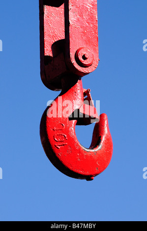 A cranes hook painted red against a blue sky. Picture by Patrick Steel patricksteel - Stock Photo