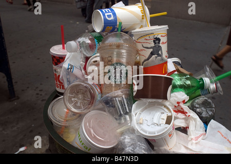 An overflowing trash can in New York - Stock Photo