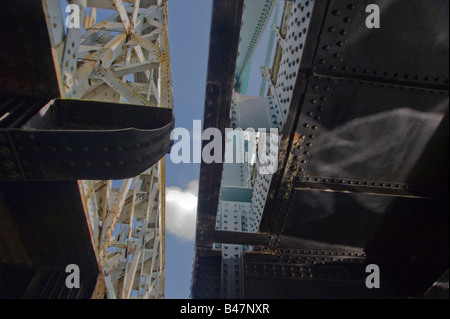 A view from beneath an Iron Bridge spanning over the Grand Union canal West London England UK - Stock Photo