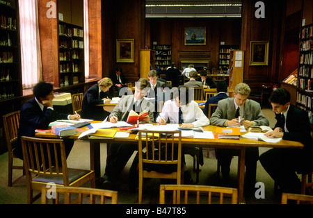 Boys working in the library during a study period at Manchester Grammer School - Stock Photo