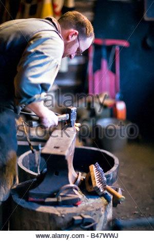 Blacksmith hammering on anvil, Festival Du Voyageur, Winnipeg, Manitoba, Canada. - Stock Photo