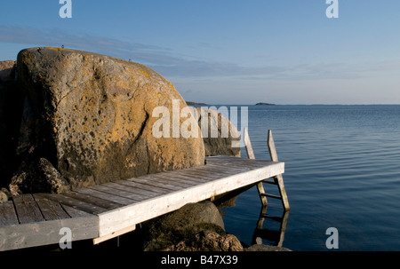 Jetty among rocks in the Stockholm archipelago - Stock Photo