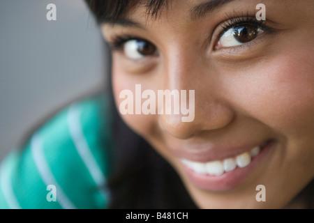 closeup of fifteen year old hispanic teenager looking at camera, girl, woman, latina latino southwestern united - Stock Photo