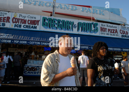 Visitors to the Gregory Paul s on the boardwalk outside Astroland in Coney Island in the Brooklyn borough of New - Stock Photo